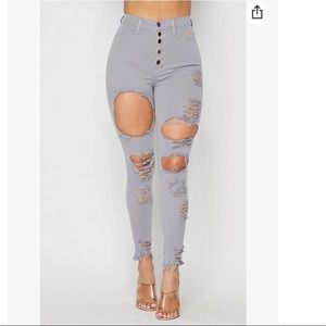 High waisted extreme ripped jeans
